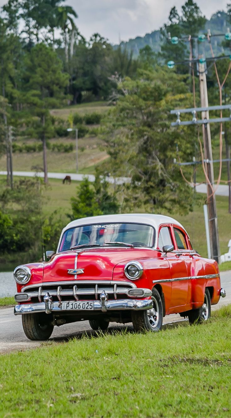 1950's Cuban classic car parked on the side of the road on our way to Las Terrazas, Cuba. The photo was taken By Lina Stock on the Divergent Travelers Photography Tour in Cuba. The Divergent Travelers Adventure Travel blog showcases great stories and some of the best travel photography in the world. We run photography tours not just in Cuba but throughout the world. Click to see more about Cuba http://www.divergenttravelers.com/two-week-cuba-itinerary/