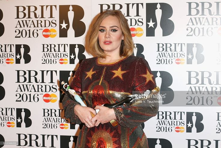 Adele poses in the winners room at the BRIT Awards 2016 with her 4 Brit awards at The O2 Arena on February 24, 2016 in London, England.