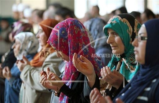 German Muslim women pray in a Mosque in Cologne, Germany, 19 September 2014. Muslims in Germany mobilized for rallies against anti-Semitism and terrorism in the name of Islam on a nation wide day of action. (Photo by: Oliver Berg/picture-alliance/dpa/AP Images)