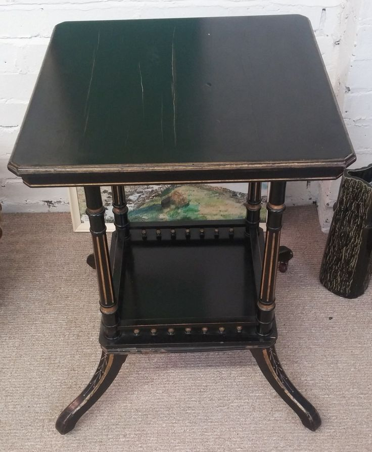 Ebonised Arts & Crafts table. Table top measures 29 inches x 18.5 inches, overall height measures 21 inches.