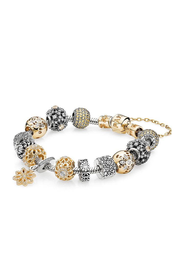 Finely crafted patterns and pretty blooms are unified in the new pieces. Combination gold and silver charms for a luxurious and timeless bracelet design that will complement any outfit. #PANDORA #PANDORAbracelet