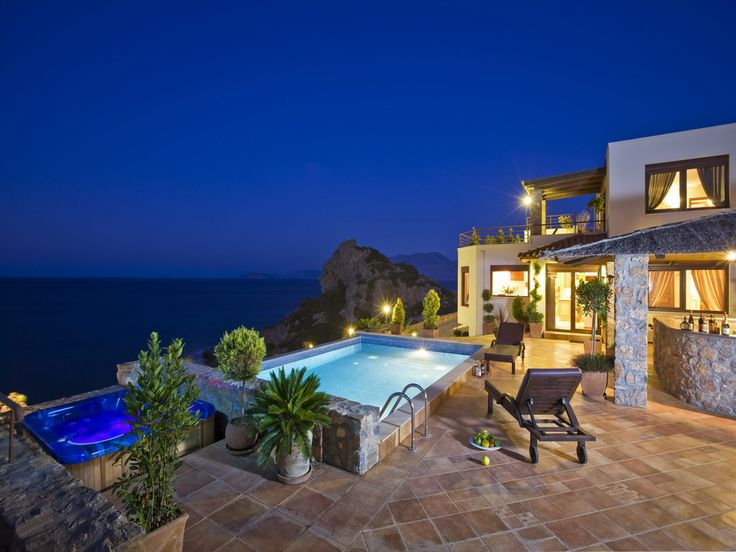 VIP Spring Villa to rent in Elounda, Crete island. The interiors are fashioned from the perfect blending of contemporary design with typical Cretan style. Villa 's floor plan includes three bedrooms (one on each floor), a living room, dining