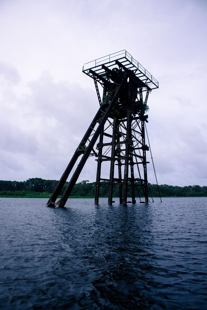This tower stands abandoned in Rio San Juan, near San Juan de Nicaragua. It was for building a canal which was never built. Read more: http://www.bizarreglobehopper.com/blog/2014/09/08/san-juan-de-nicaragua-indio-maiz/