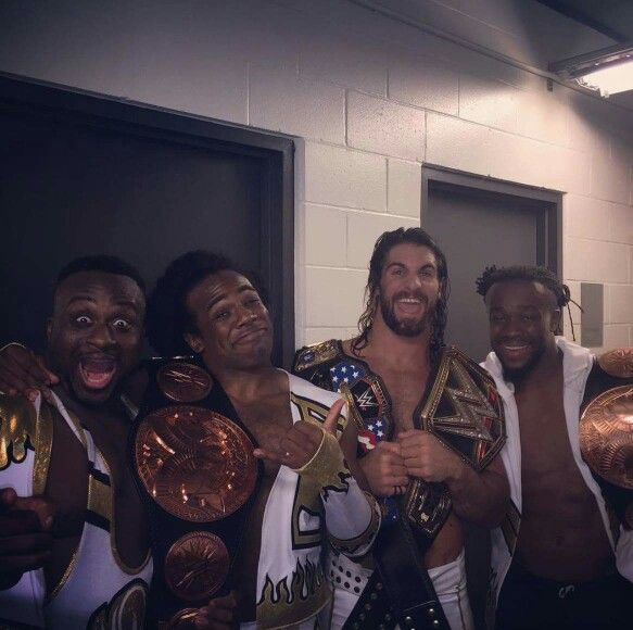 WWE Tag Team Champions The New Day celebrating with WWE World Heavyweight and United States Champion Seth Rollins at SummerSlam.