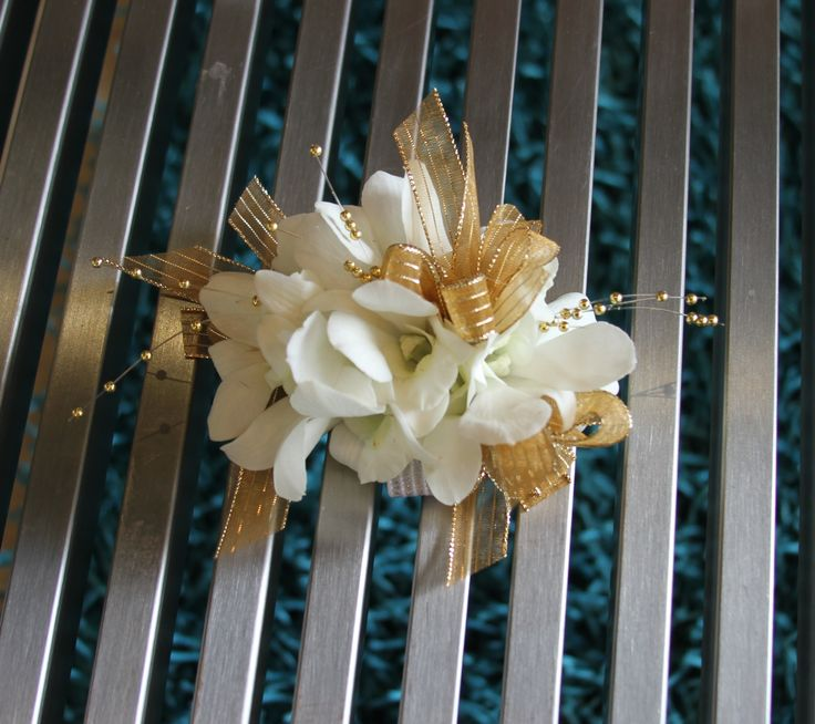 White Dendrobium Orchids with Gold Pearls Corsage.  Terra Flowers Miami. Perfect for Weddings, Proms or Graduations. Please visit www.TerraFlowersMiami.com for ordering details.