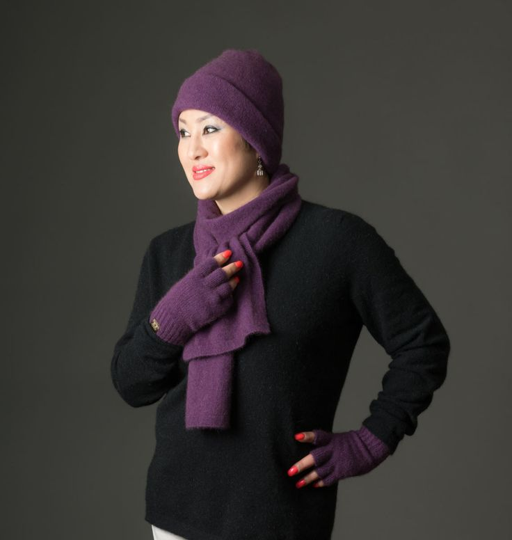 This is a lovely soft and warm purple scarf with a nice knitted edge detail in grape purple. Team this scarf up with the matching Grape beanie and fingerless gloves.  This scarf is 185cm long by 17cm wide including the lovely ribbed border.  A lovely blend of possum fiber mixed with merino lambs wool and nylon for strength. Soft and cosy, possum merino is a special blend of wool that is comfortable and very warm. A unisex design suitable for both men and women.