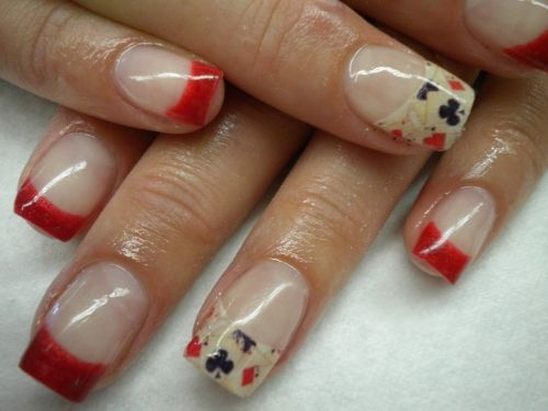Nail art:   Red french tip manicure with playing card symbols nail art design