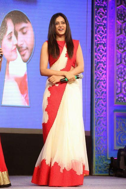 Rakul Preet Singh Photos in Red White Saree Sleeveless Blouse Smee Audio LaunchIndian Ramp