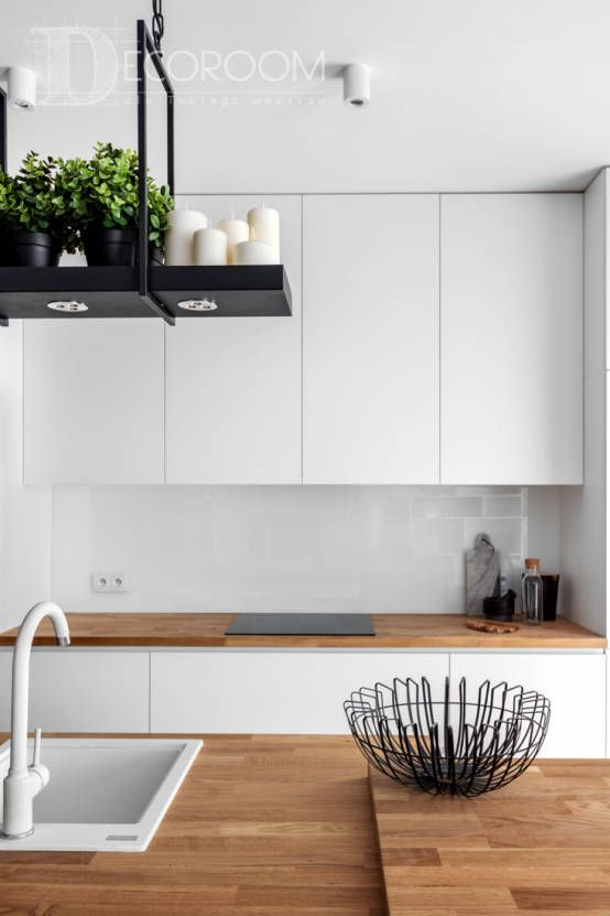 Jak dobrać oświetlenie do kuchni- dowiedz się tu: https://www.homify.pl/katalogi-inspiracji/379438/jak-profesjonalnie-dobrac-oswietlenie-do-kuchni
