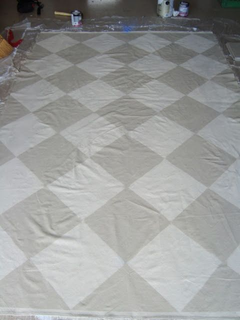 A tutorial on how to make a floorcloth. http://decortoadore.blogspot.com/2010/10/tutorial-creating-painted-floorcloth.html . I have made a small runner for my cabin for 1812 reenacting.