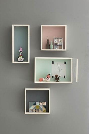 Colorful-backed shelves - black shelves with purple and lime green backing on my grey walls