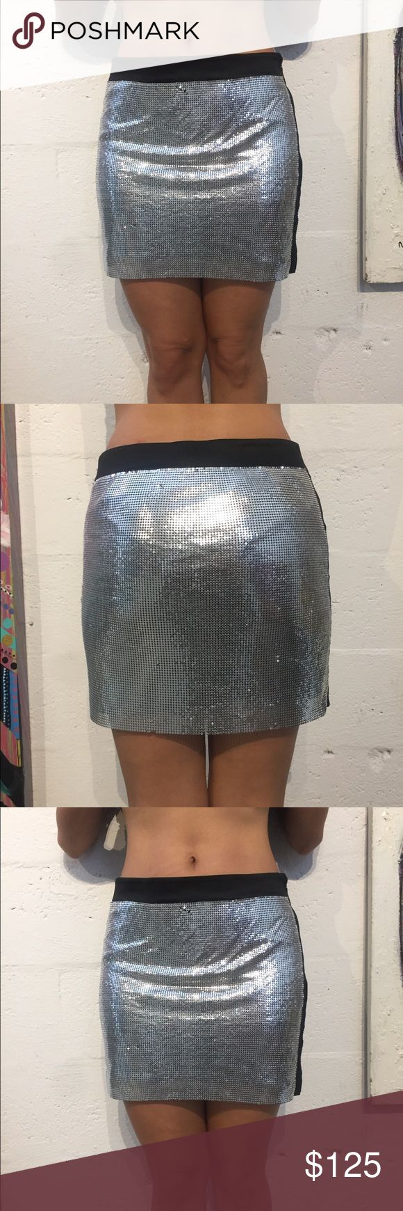 Bebe xxs mesh silver black skirt mini club dancer Bebe xxs mesh silver black skirt mini club dancer  There is two Little mesh beads missing the connectors.  You have to look closely.  But in overall it's in great condition bebe Skirts Mini