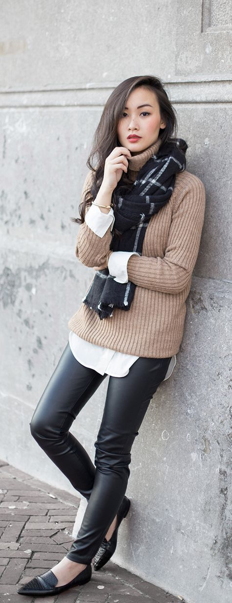 Levi Nguyen is wearing a brown turtleneck from Mango, trousers from Shopbop and a scarf from Zara