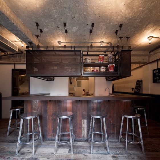 It's a purposefully unpolished interior that we find at The Commune Social in the Jing-an district, with reclaimed wood left looking distressed, metal left bare, unfinished concrete and exposed brick...