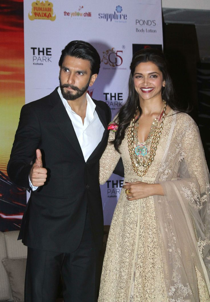 Ranveer Singh and Deepika Padukone during promotion of their upcoming film `Ram-Leela` in Kolkata. Deepika wowed a gown by Anushka Khanna. #bollywood