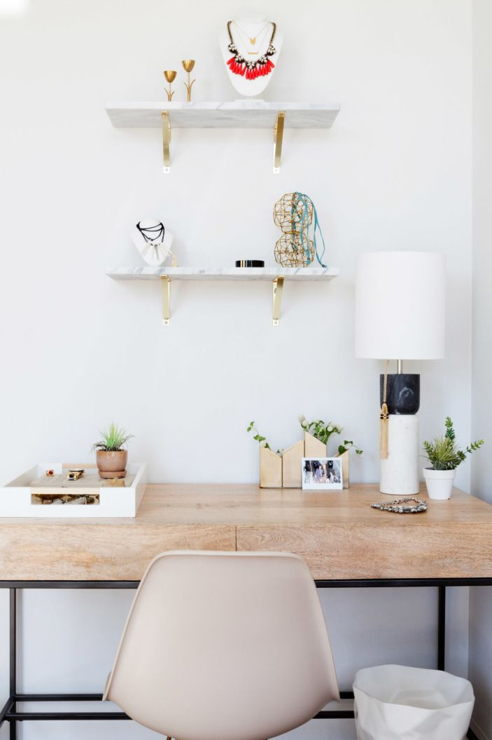 """The raw mangowood <a href=""""http://www.westelm.com/products/rustic-storage-desk-h205/?pkey=coffice-desks%7C%7C"""" target=""""_blank"""">desk</a> is adorned with beautiful brass objects."""