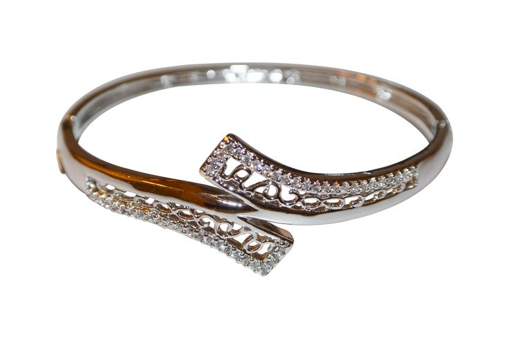 Sterling silver cuff bypass bracelet is set with micro pave cz's and shimmers as you move.  This stunning bracelet has a filigree finish inside the bypass.  This is going to be your new favorite piece!