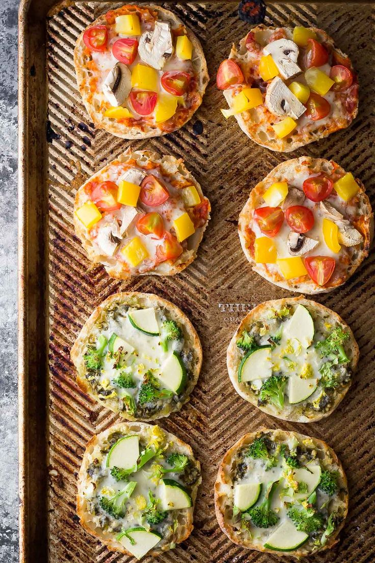 Freezer Mini Pizzas 2 Ways: with pizza sauce and with pesto (green goddess). These are the perfect healthy meal prep snack that you can make ahead and stash in the freezer!