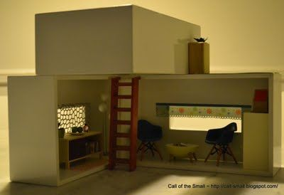 DIY dollhouse made from tissue box covers - looks easy to construct, but also simple and sturdy to play with
