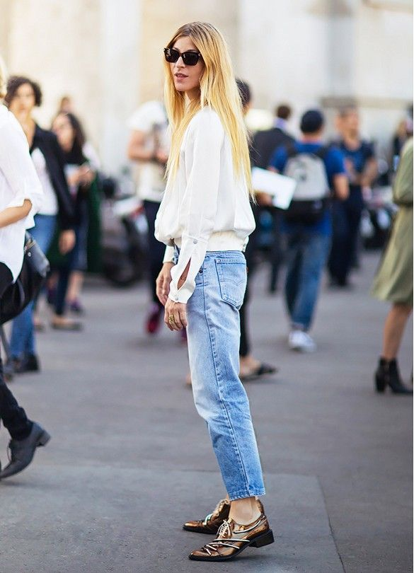 A white blouse is worn with cropped Levi's jeans, statement oxfords, and black sunglasses