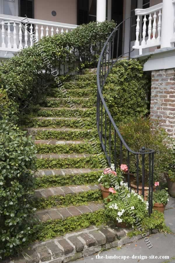 Wrought iron and brick spiral garden steps - Along with the wrought iron and brick, the plants growing on the steps as well as the railing is awesome and has such a cool feeling to it much more than just plain hard brick would.