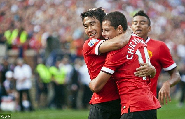Victory sealed: Javier Hernandez celebrates with Shinji Kagawa after scoring United's thir...