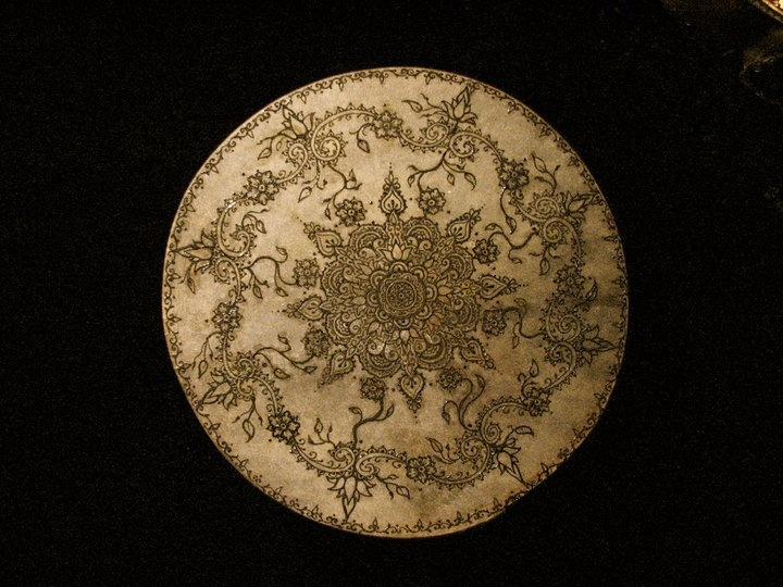 Original henna art on Moroccan frame drum by Antoinette Marie Zagata. Mandala.