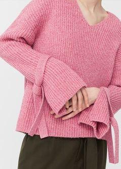 Pullover fiocchi decorativi