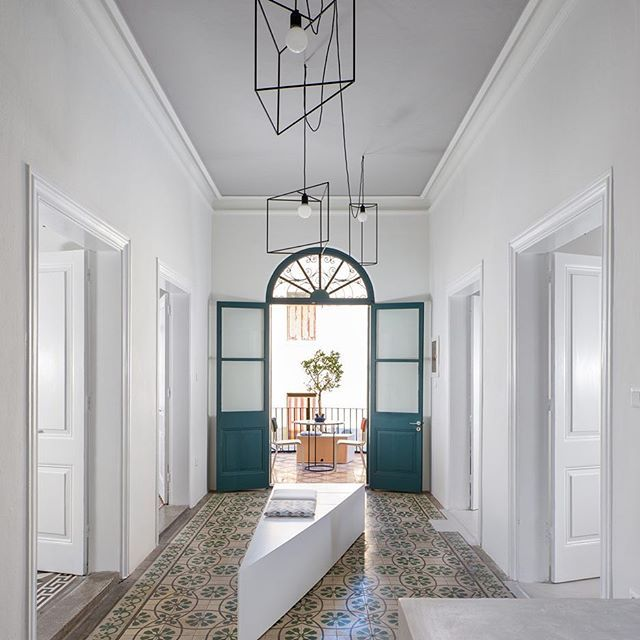 The old bones of a 1912 building have been preserved in its renovation into a plastic surgery practice on the Greek island of Rhodes.  Head to dezeen.com/tag/renovations to see this and more interior overhauls.  #interiordesign #renovation #rhodes #greece