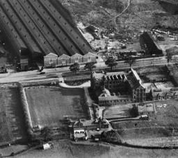 The Longbridge Motor Works and Nazareth House, Longbridge, 1928. This image has been produced from a damaged negative. | Britain from Above