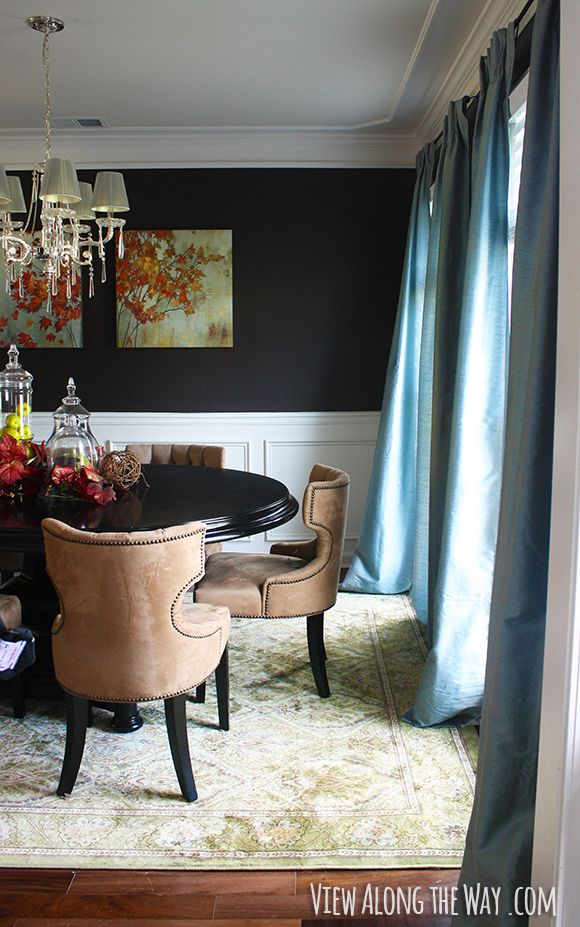 Dining Room With Dark Walls Crown Molding And Chair Rail
