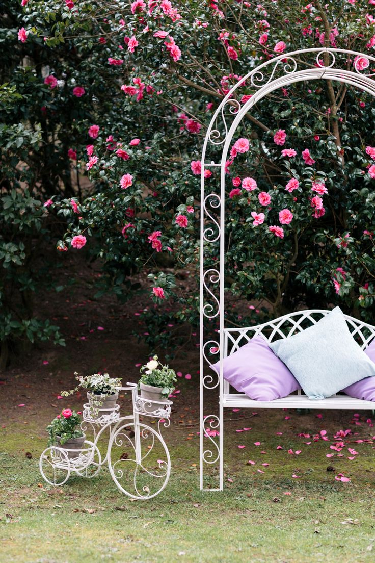 Add a cream vintage garden planter for a sweet floral feature or sit pretty with a gorgeous garden arch and bench