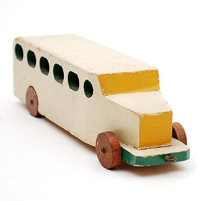 Wooden white-painted bus with green and yellow accents on four brown wheels design Ko Verzuu ca.1935 executed by ADO Arbeid Door Onvolwaardigen Berg en Bosch / the Netherlands