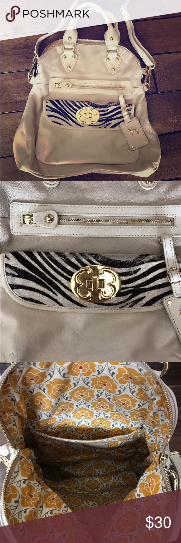 """Emma Fox cream leather bag with zebra fur Emma fox tan/cream leather bag with zebra fur on pocket.  Adjustable shoulder/cross body strap, or can hand carry. Large size - approx 17""""x15""""x4"""". Does have wear on zebra fur but it's not very noticeable (see pic), also some wear on handles.  Clean inside. Emma Fox Bags"""