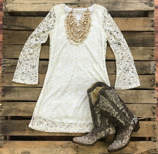 Southern fried chics white lace bell cuff boho wedding dress. Casual embroidered cowboy boots. Statement necklace.