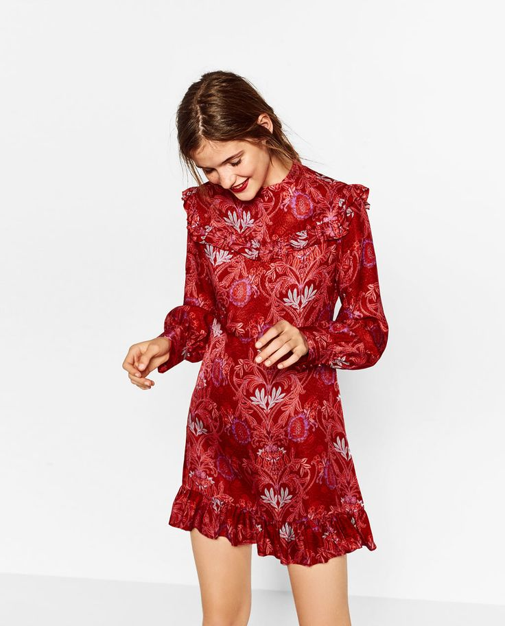 JACQUARD MINI DRESS from Zara.  Maybe a bit more 70s but would look great with the white gogo boots!