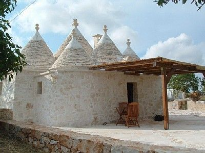Trullo - A trullo is a traditional Apulian dry stone hut with a conical roof. Their style of construction is specific to the Itria Valley, in the Murge area of the Italian region of Apulia. Wikipedia