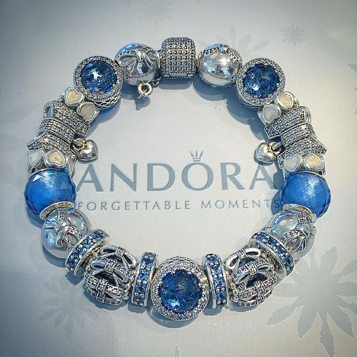 """""""Crystal blue and sparkling bows are a great start to our winter collection! Come by our location and see our new Winter Collection! @pandora_at_the_falls…"""""""