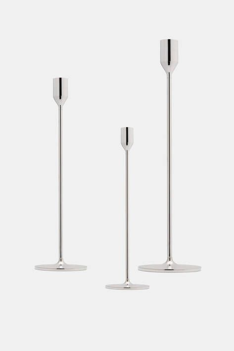 "Founded by King Karl IX of Sweden, Skultuna draws upon centuries of experience to produce fine metal objects such as this silver-plated candlestick, designed in 2011 by Richard Hutten. ""I am more concerned with the structure, the basic shape,"" he says. ""You can follow the syntax of the design process—the design can be understood immediately."" The graceful form elevates a single taper on a slender stem and a simple disc base. Also available in medium and large sizes."
