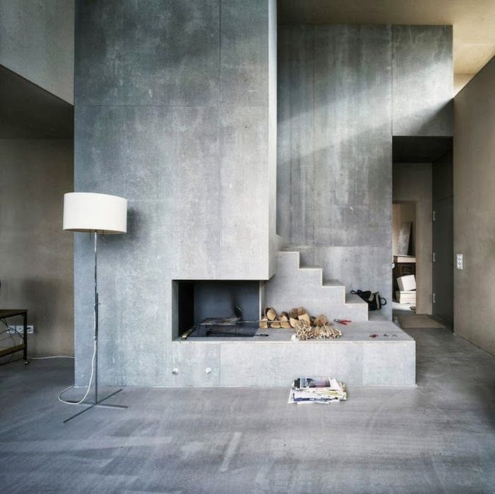 I'd soften it up a lot with other things, but as a base I really like the stairs, floor, and fireplace all melding together in concrete.