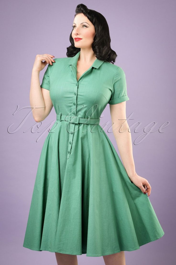 The combination possibilities are endless with this50s Caterina Swing Dress!  A beautiful shirt dress which isn't only suited for a retro look in the evening, this stunning swing style with playful buttons is also very suited for a day at the office! Her elegant V-neckline, lapel collar, short sleeves and belt which will give you a stunning feminine silhouette, will make you feel like a real woman. Made from a sturdy mint green cotton blend with a light stretch, that has the loo...