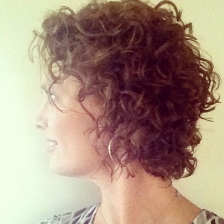 Short curly hair rounded around the face to add a softness and texture to the front. It is a nice change from the inverted bob.