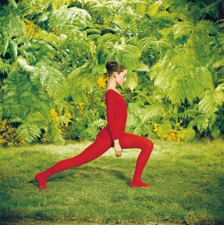 Your next outfit at the gym? Dressed in a striking red leotard Audrey exercises in the garden.  2010 Bob Willoughby