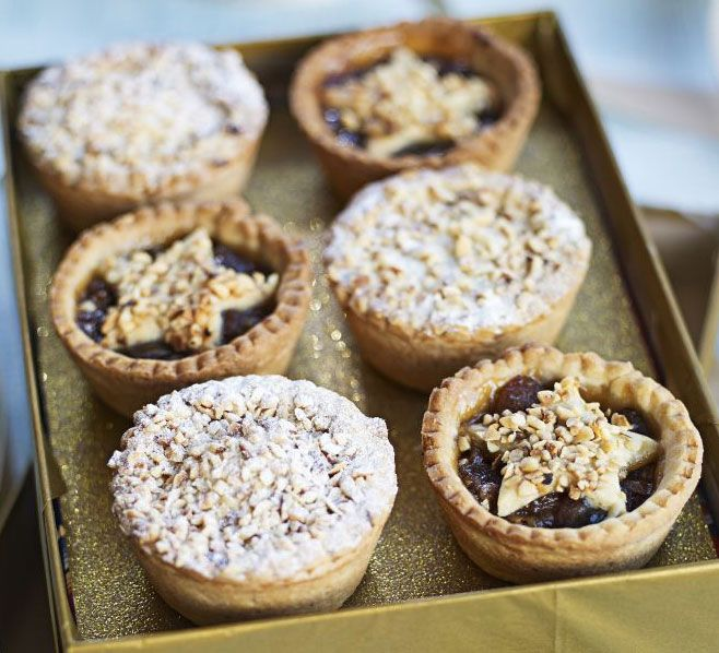 Jazz up your homemade mince pies by adding grated apple and orange zest - try a pretty star shaped lid, finished with a crisp nutty topping