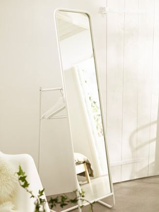 IKEA KNAPPER standing mirror with a clothing rack attached to it!