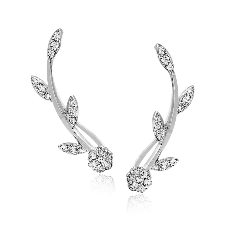 These climber earrings extend up the ear with a floral-inspired 18k white gold d...