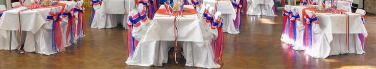 Mixed Red, White and Blue Organza Bows on White Chair Covers