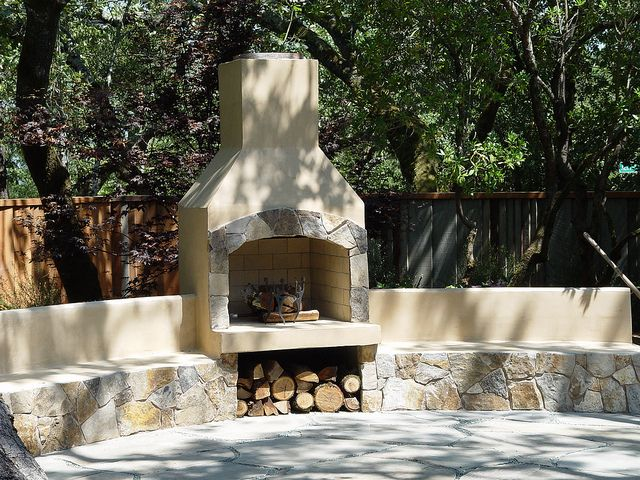 """36"""" fireplace opening finished in stucco with stone seating walls by Hedberg Landscape, via Flickr"""