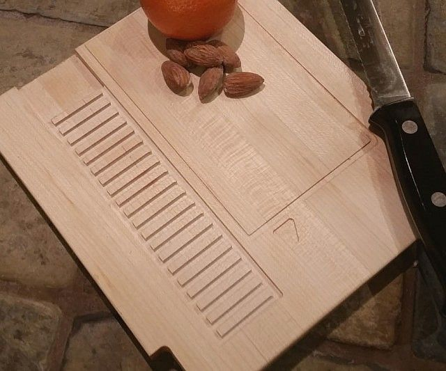 Prepare your meals like any self respecting gamer would by chopping up your ingredients on the NES cartridge cutting board. Made from resilient maple, walnut, cherry, and mahogany, this custom board comes molded in the shape of a classic NES cartridge!