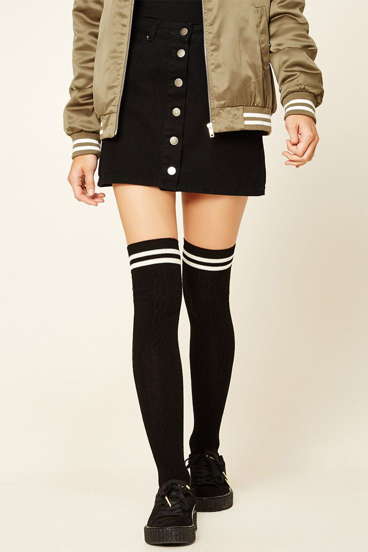 A pair of cable knit over-the-knee socks featuring varsity stripes.